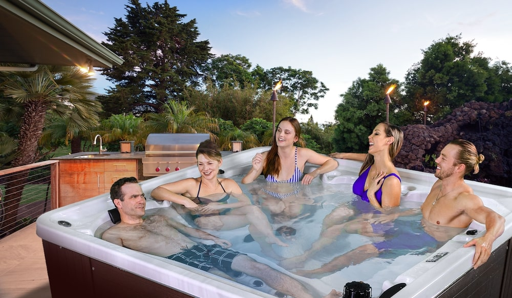 Arctic Spas Grizzly with people